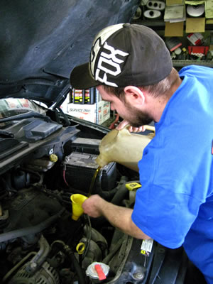 Checking engine fluids at Prime Auto Sales Omaha.